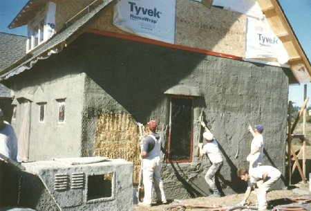Pictue of crew doing the stucco